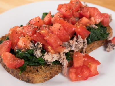 Tomato, spinach and sardines on toast