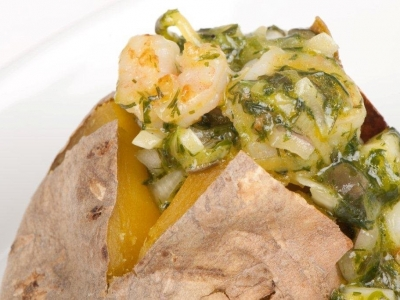 Baked kumara with herb and prawn sauce