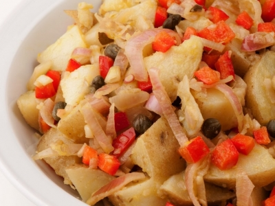 Warm potatoes, shallot and red capsicum salad