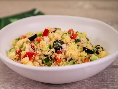 Greek cucumber salad with tomato and couscous