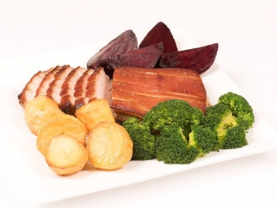 Pork belly with broccoli, beetroot and roast potatoes